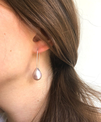 pink white pearl earrings on a stem worn by Editions LESSisRARE pearls