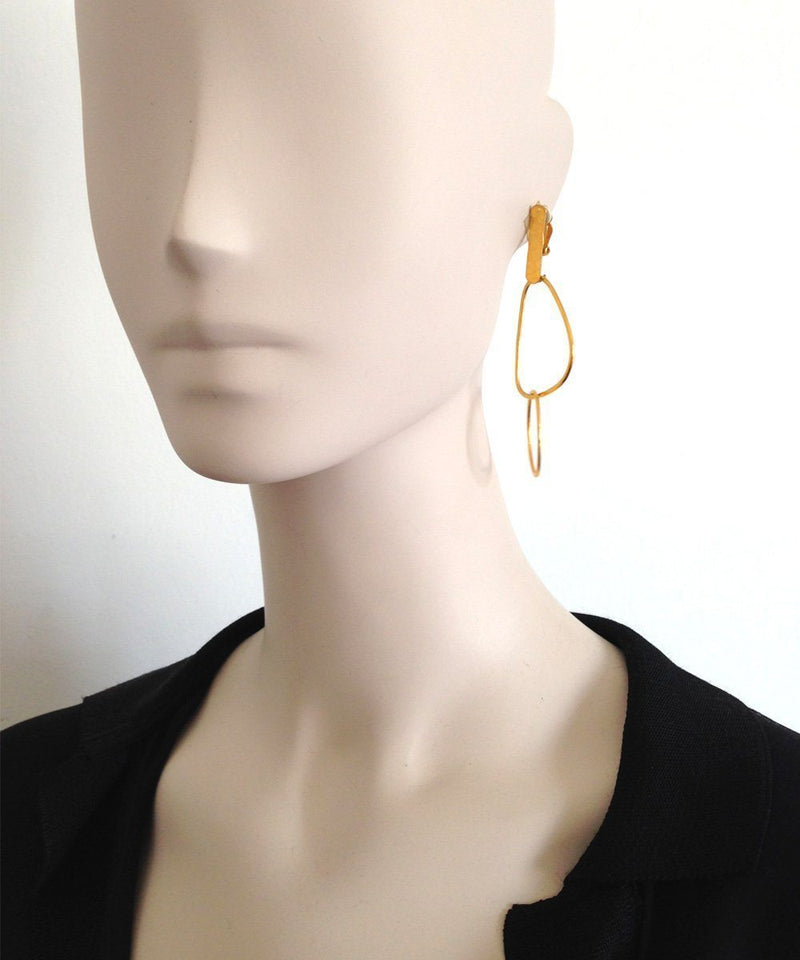 "Gold interwoven shape clip earrings - ""Over the water"" designer Eloise fiorentino"
