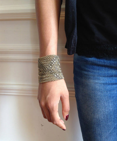 cuff-bracelet-in-mesh-metal-aged-gold worn Editions LESSisRARE Jewels