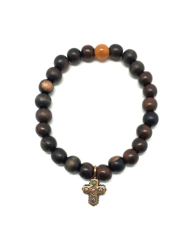 Catherine Michiels-wrist-stardust-pearl-wooden-cross-all-holy-bronze-saphires.jpg