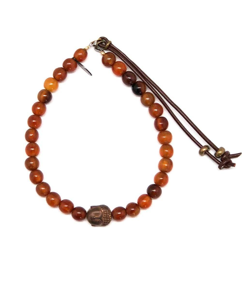 Catherine Michiels Amber bracelet and buddha buddha head Starstst creator