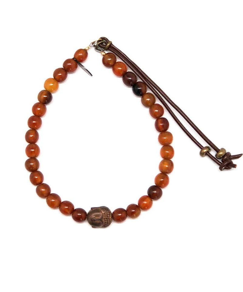 Amber bracelet and buddha buddha head Starudst - Catherine Michiels