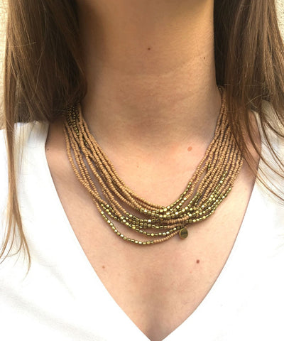 necklace jumper beads beige and gold worn 3 towers Fonsi