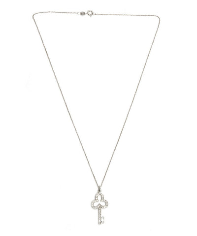 bernard-delettrez-collier-cle-en-or-et-diamants-fleur 1