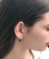small black hoop earrings worn by eloise fiorentino