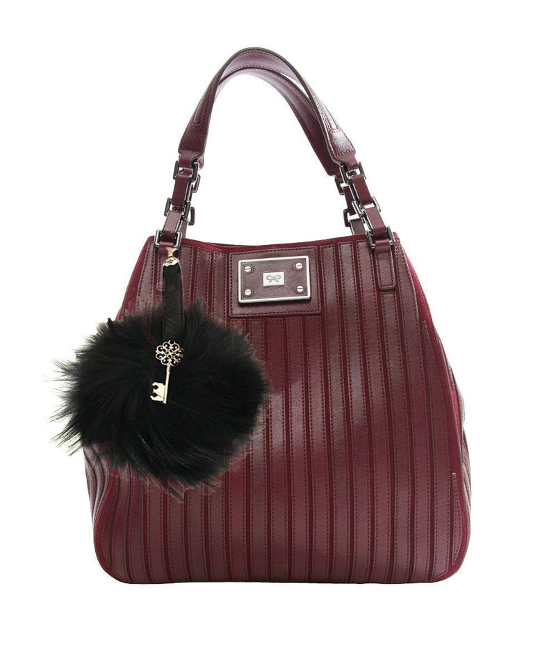 Tassel bag charm in marmot and black leather Editions LESSisRARE