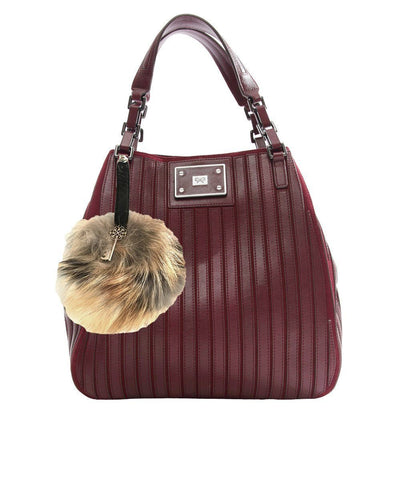 Pompon bag charm in marmot and leather Editions LESSisRARE worn