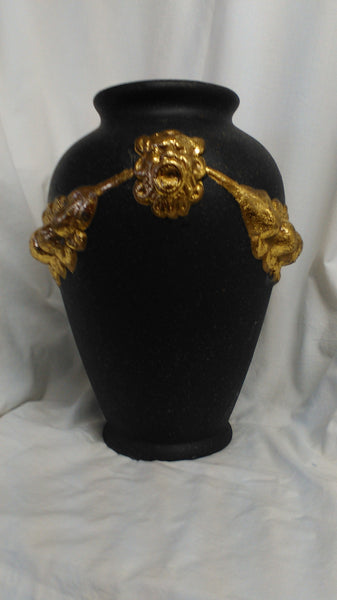"12"" Tall ash black vase sprinkled with gold and decorated with goldish leaves, lion heads and fruit linked by tassels."