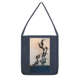 "This long-strap printed tote bag is made from 100% recycled materials. Stylish, and environmentally friendly too! Also features a hidden metal snap fastening for added security. Size is 13"" x 14.5"", strap length approx. 31""."