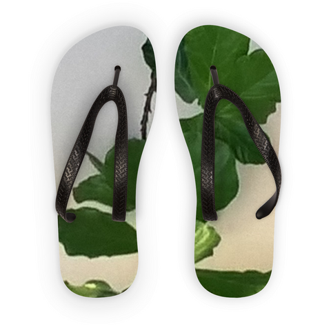 White and green plant design flip flops. Price, 22.99. Three sizes, sm, med, large