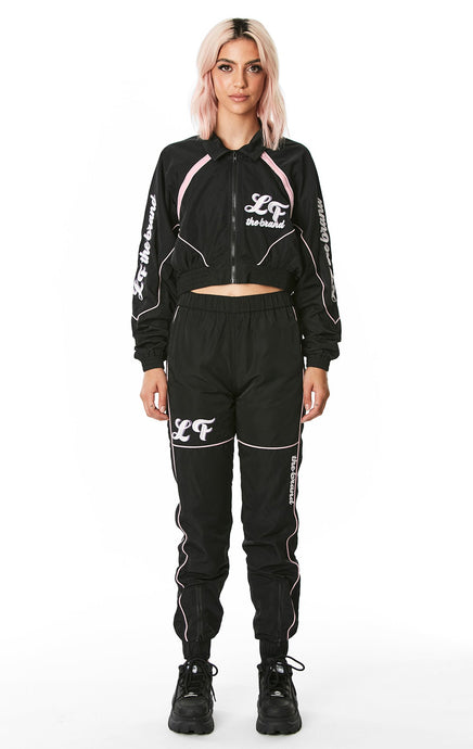 ZIP BACK WINDBREAKER PANT WITH EMBROIDERY