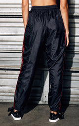 WINDBREAKER TRACK PANT WITH RED AND WHITE TAPE SIDE TRIM