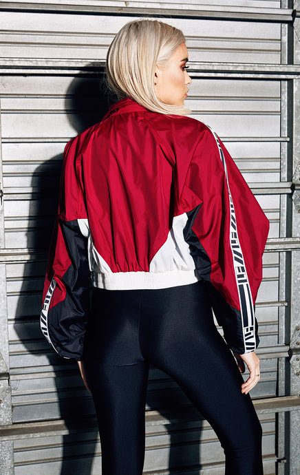 CROP COLOR BLOCK WINDBREAKER WITH ZIPPER ACCENTS AND WHITE LF TAPE