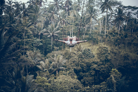 Man on Swing in Jungle - Green Toursim, sustainable travel
