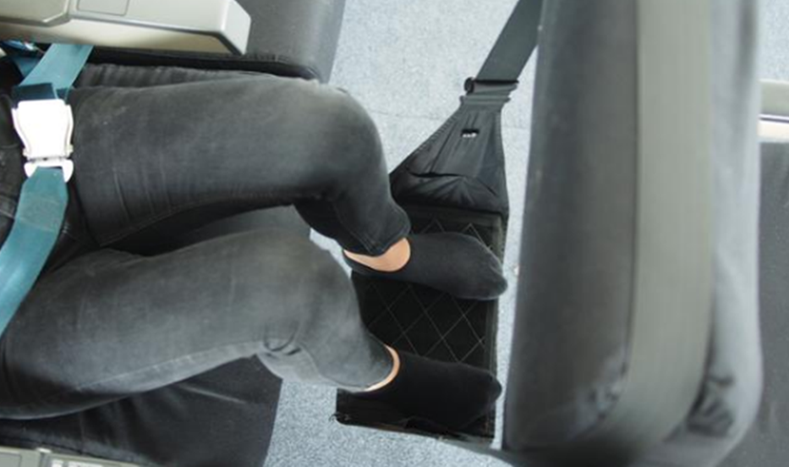 Travel Footrest increasing travel comfort by supporting knees and legs