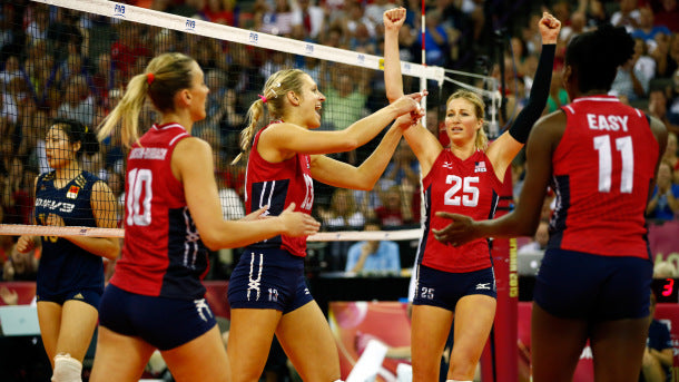 OMAHA, NE - JULY 26: Jordan Larson-Burbach #10, and Christa Harmotto Dietzen #13, Karsta Lowe #25 and Megan Easy #11 of the USA celebrate after a point during the final round match against China on day 5 the FIVB Volleyball World Grand Prix on July 26, 2015 in Omaha, Nebraska. (Photo by Jamie Squire/Getty Images for FIVB)