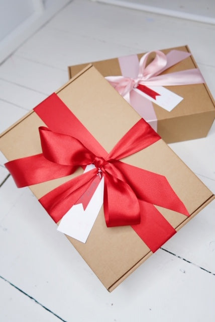 KIHTMAS BOXES WITH RED AND PINK RIBBON