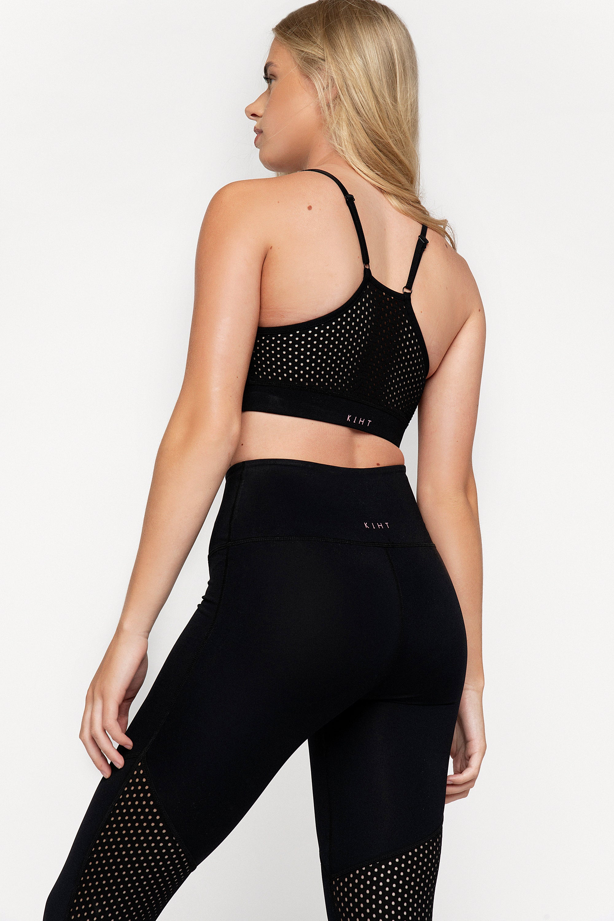 Black strappy crop top with scoop neck punched panel detail on the front and back. Adjustable straps, removable bust cups and compressive super soft fabric make it both comfy and super cute.  Back