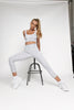 High waisted pale snake print gym leggings, wide supportive waistband. Detailing seams down the front and back of the legs, compressive flattering fit. ⅞ leg length