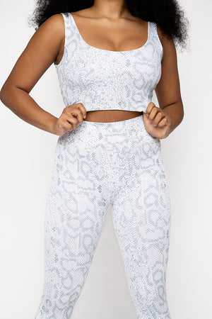 UK ethical activewear Scoop neck crop tank top in white pale snake print. High compression fabric, panelling detail flatters and supports. Low scoop back detail.
