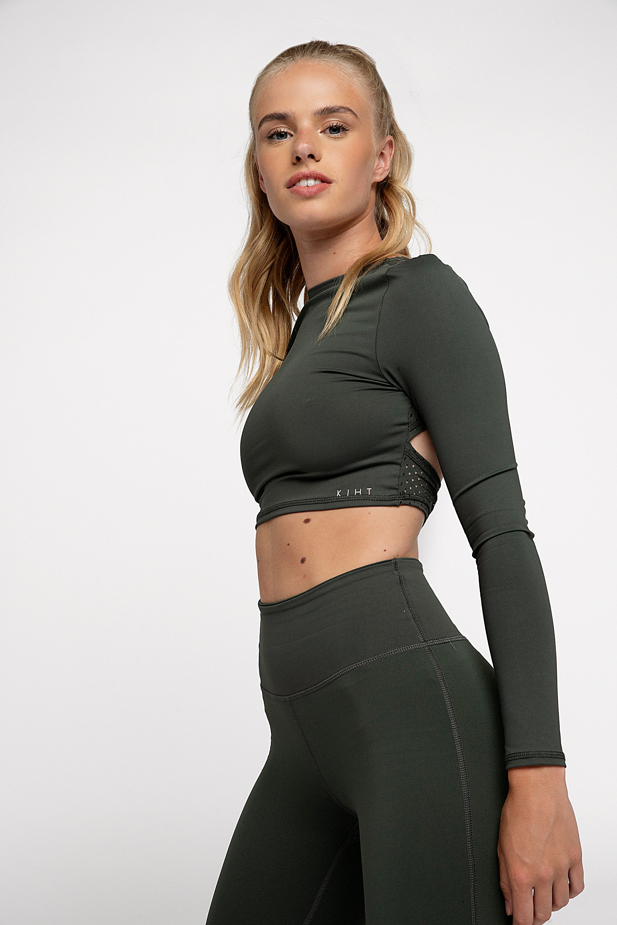 UK ethical activewear Long sleeve gym crop top in green jungle khaki colour with punched panel back detailing