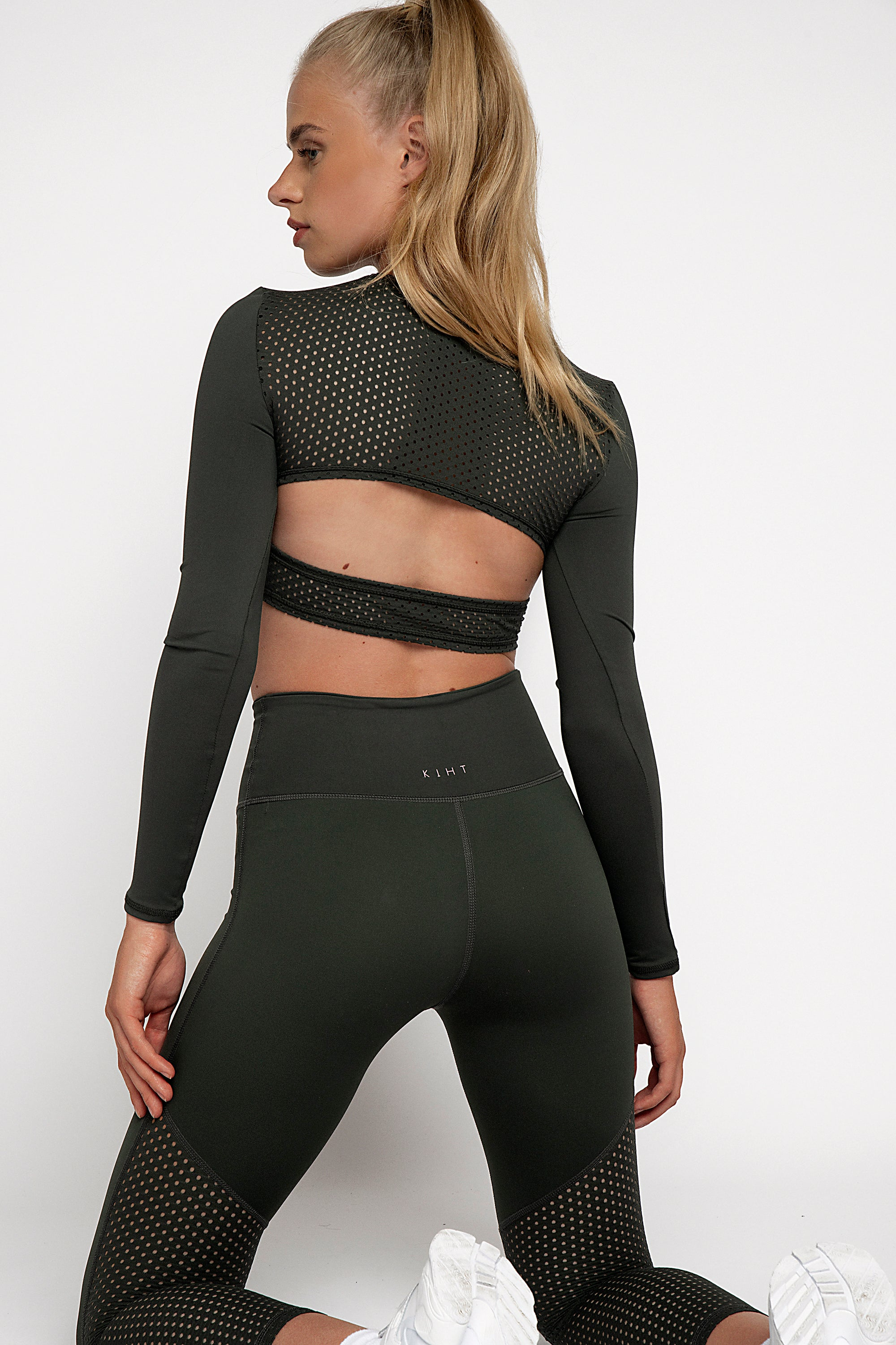 UK ethical activewear Long sleeve gym crop top in green jungle khaki colour with punched panel back detailing on back