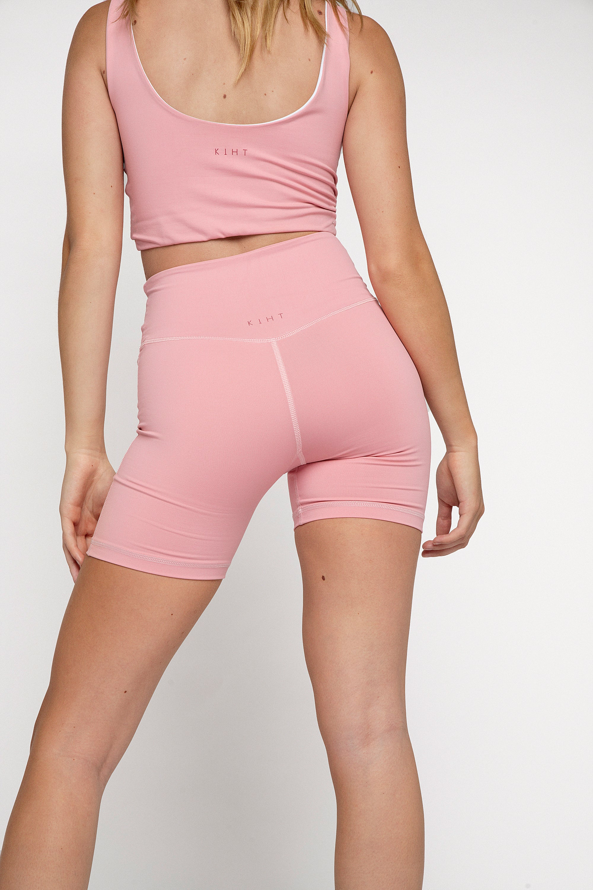 High waisted flattering bike short in Pink Lemonade. Compressive fit and super soft fabric, wide supportive waistband that v's at the back and flatters to butt. Back