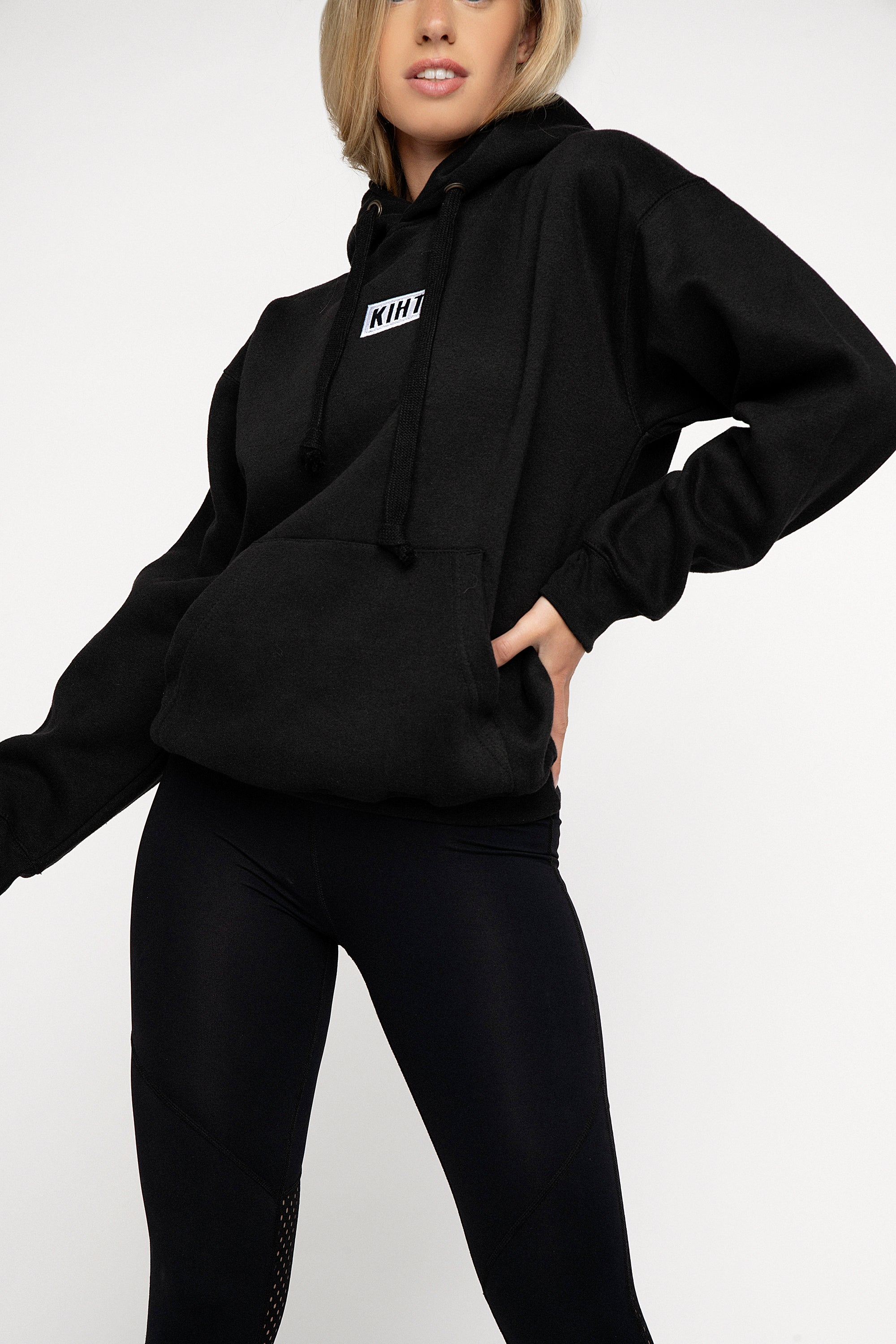 Black slightly oversized drop shoulder unisex hoodie with Kiht logo embroidered patch on the front in contrasting white. Super soft thick fabric with chunky cord detail and hidder inner pockets make this our ultimate hoodie. Front
