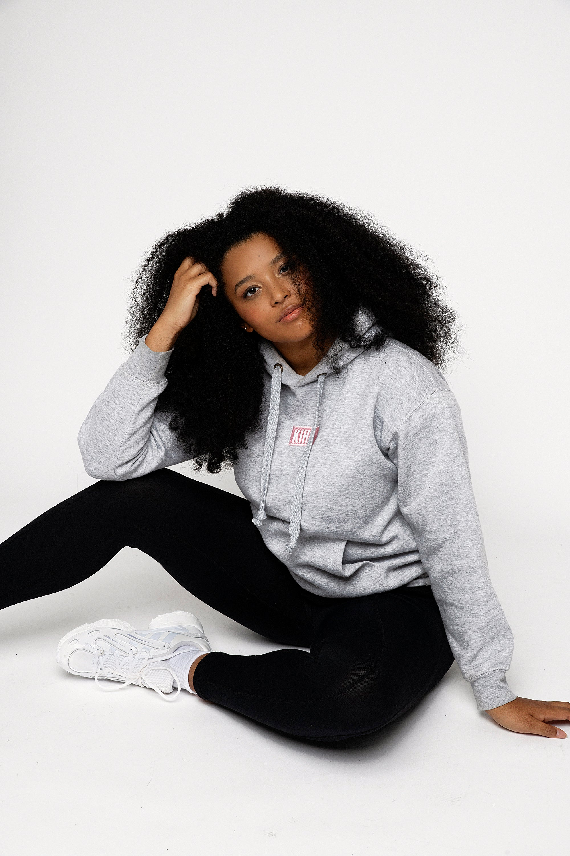 Light Grey Marl slightly oversized drop shoulder unisex hoodie with Kiht logo embroidered patch on the front in pink and white. Super soft thick fabric with chunky cord detail and hidder inner pockets make this our ultimate hoodie.