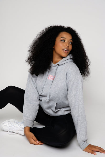 Light Grey Marl slightly oversized drop shoulder unisex hoodie with Kiht logo embroidered patch on the front in pink and white. Super soft thick fabric with chunky cord detail and hidder inner pockets make this our ultimate hoodie. Front