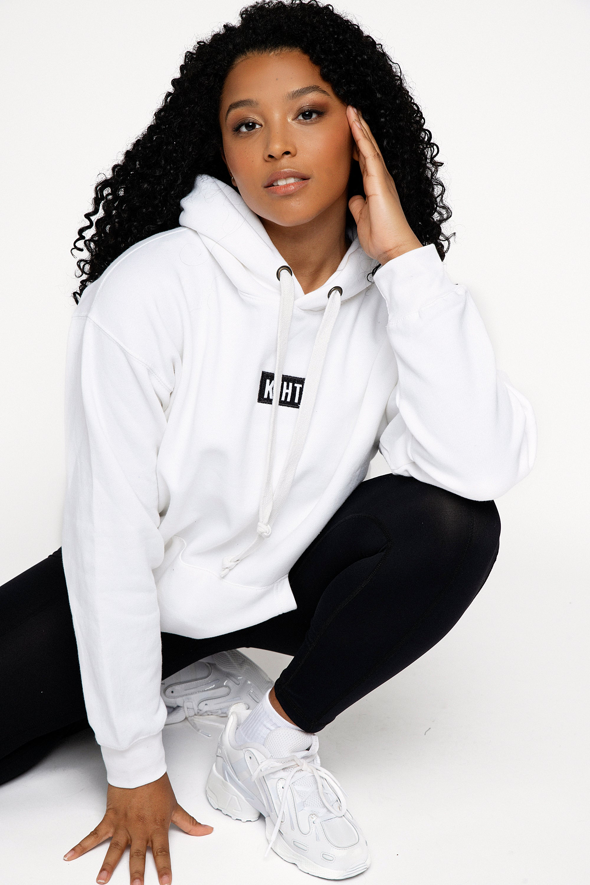 White slightly oversized drop shoulder unisex hoodie with KIHT logo embroidered patch on the front in contrasting black. Super soft thick fabric with chunky cord detail and hidder inner pockets make this our ultimate hoodie. Front