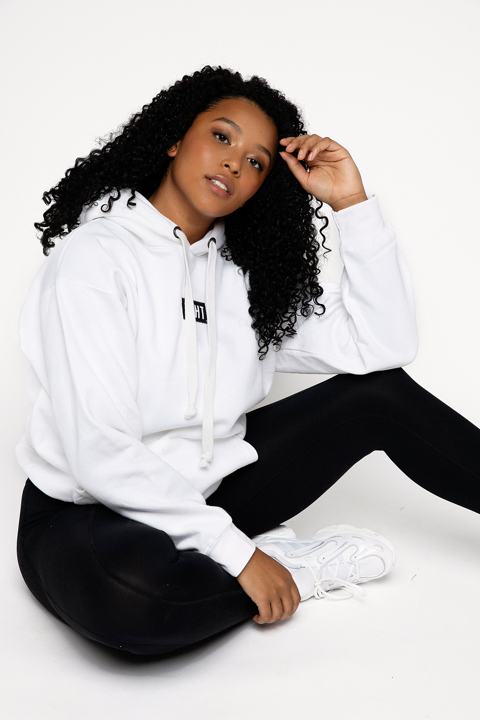 White slightly oversized drop shoulder unisex hoodie with KIHT logo embroidered patch on the front in contrasting black. Super soft thick fabric with chunky cord detail and hidder inner pockets make this our ultimate hoodie.