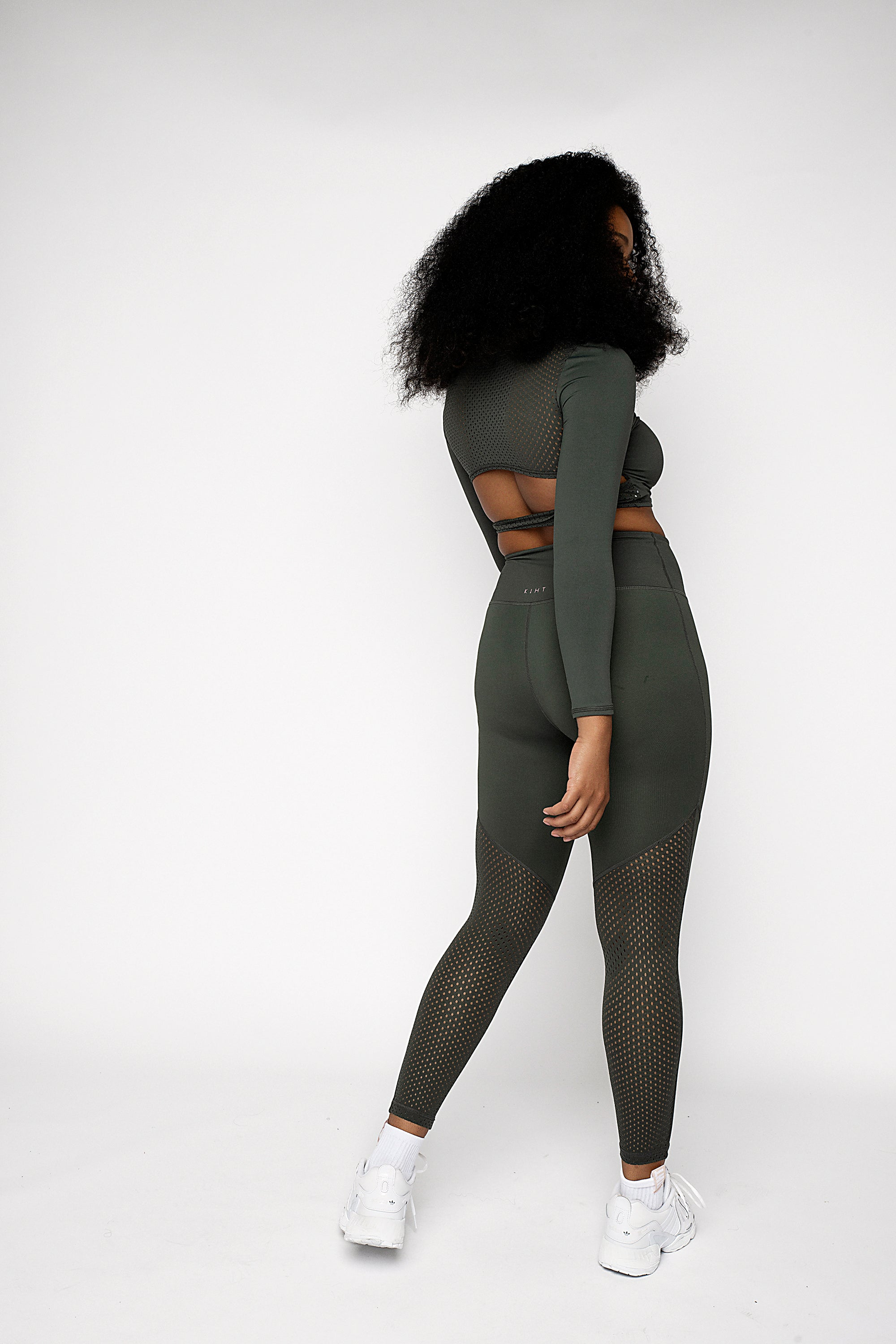 High waisted jungle khaki gym legging with punched panel back detail on the legs. Angled flattering seams on the front and back, compressive flattering fit