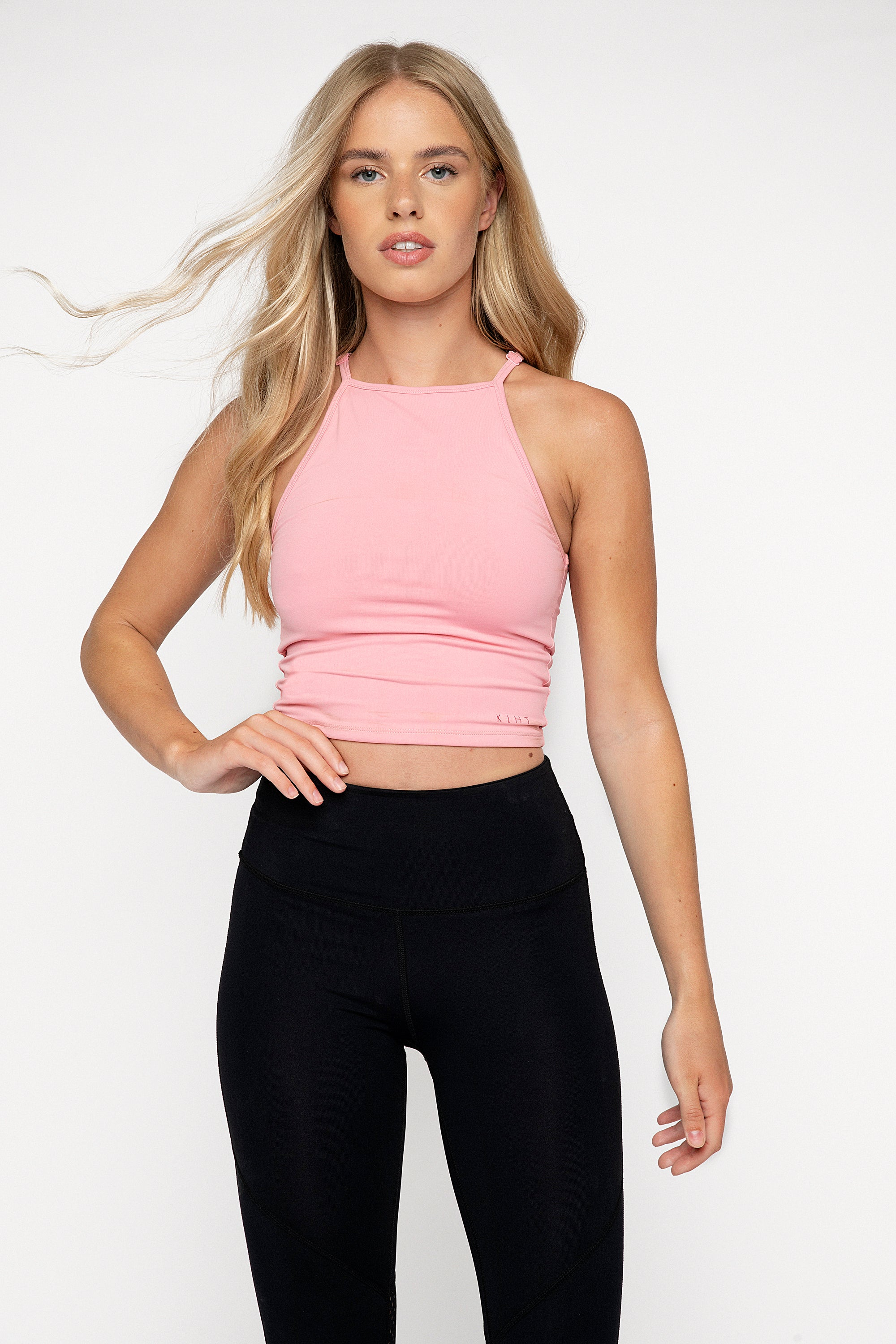 90's style high neck fitted gym top. Mid crop length with adjustable straps, double lined for support. Pink Lemonade colour.