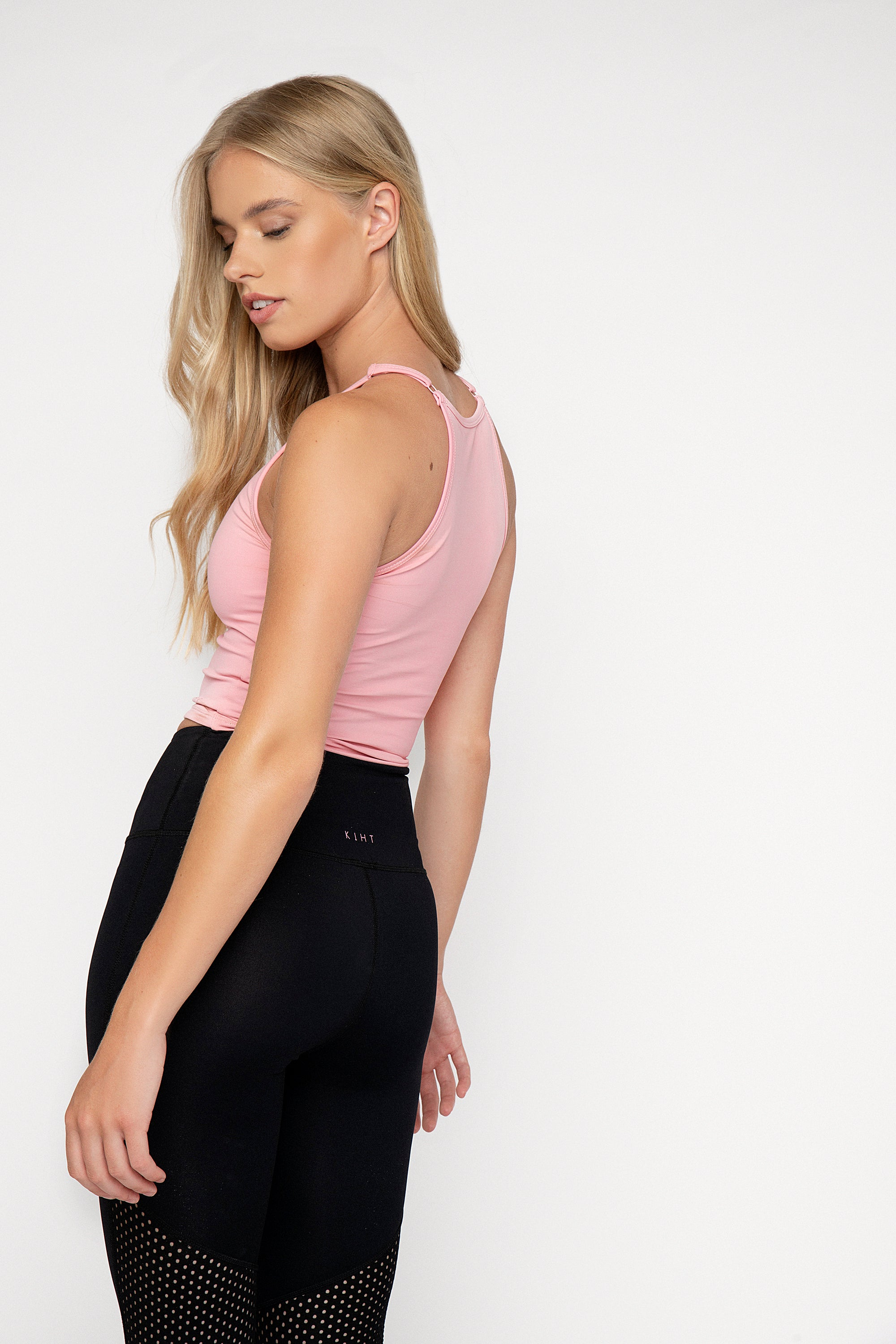 90's style high neck fitted gym top. Mid crop length with adjustable straps, double lined for support. Pink Lemonade colour. Back