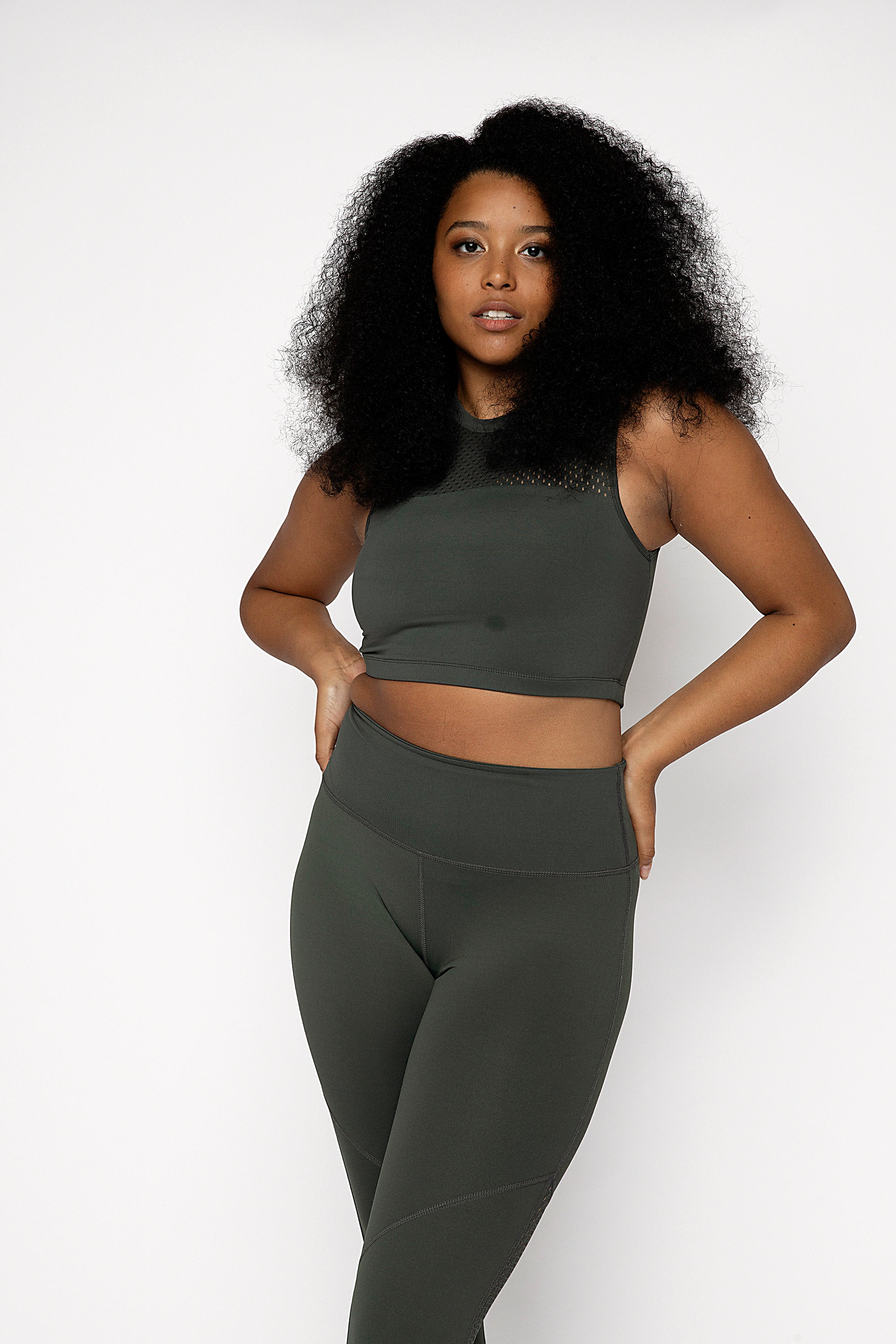 Jungle Khaki high neck supportive gym crop top with punched panel detail on the front and back. Double lined at the front for support and super fitted, cropped length