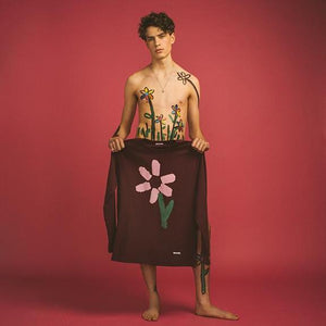 Slim Pickings Tee Maroon with Pink Vacant Daisy Flower by artist John Booth for BLOUSE by Geoffrey J Finch. Image 1.