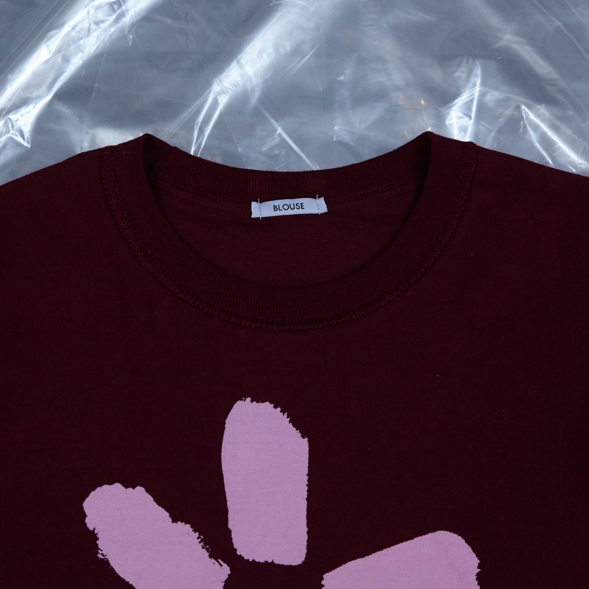 Slim Pickings Tee Maroon with Pink Vacant Daisy Flower by artist John Booth for BLOUSE by Geoffrey J Finch. Image 4.