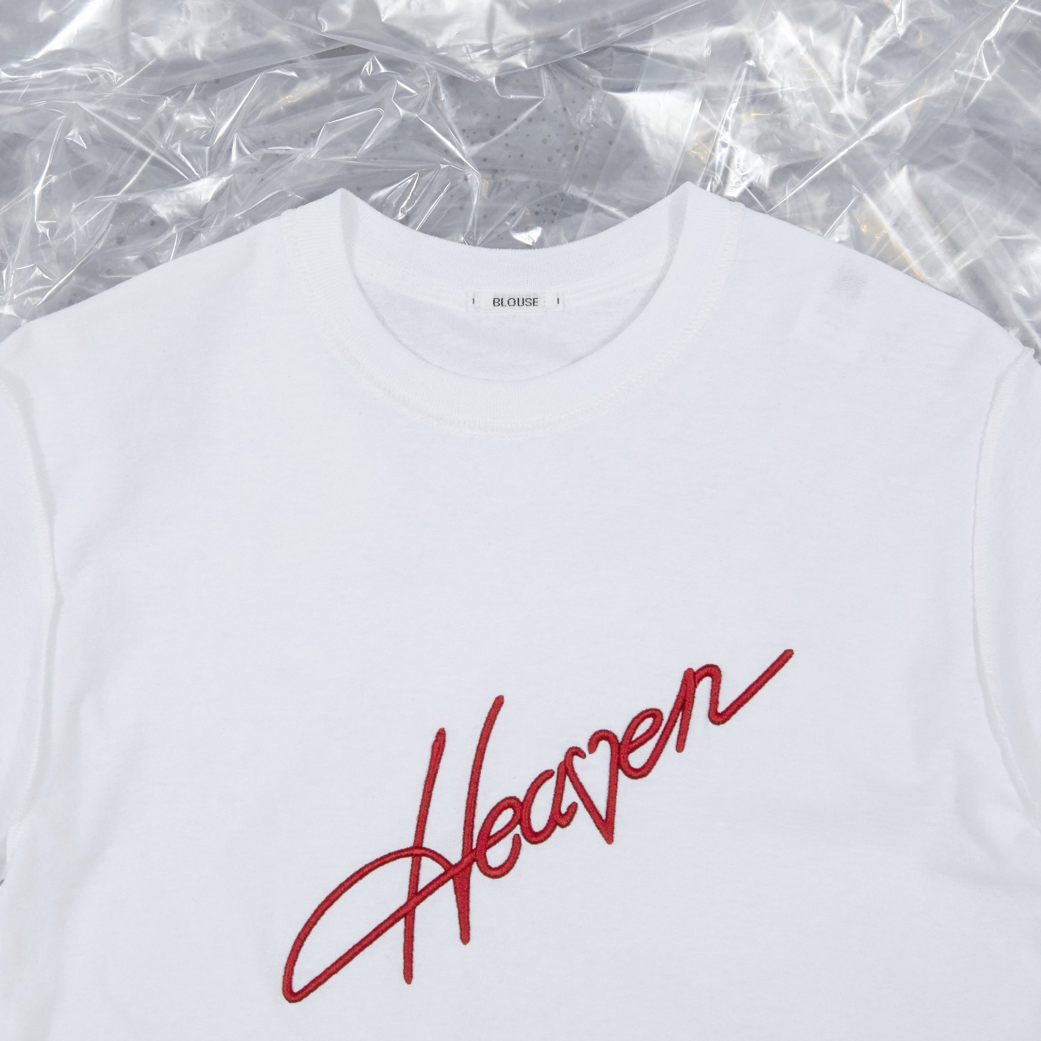 Heaven Tee White with Red Embroidery from BLOUSE by Geoffrey J Finch. Detail Image 1.