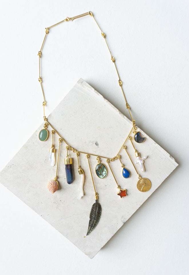 GRAINNE MORTON CHARM DROP NECKLACE WITH FEATHER