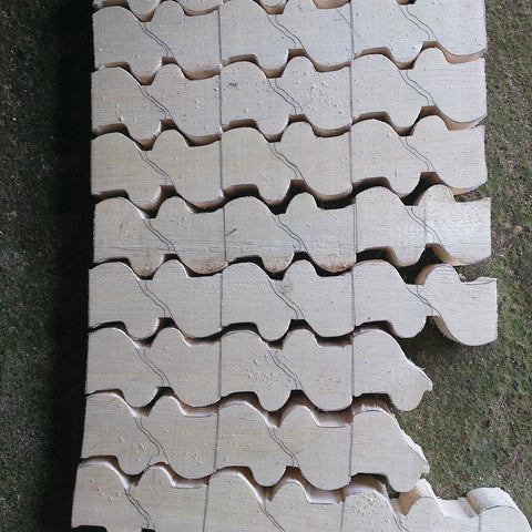 Sections of roughly shaped wood, starting to show animal shapes