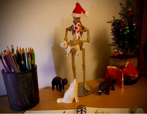 Christmas scene with a wooden skeleton and wooden animal toys