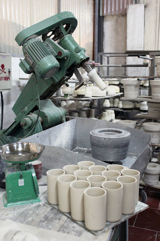 Ceramics being moulded by machine