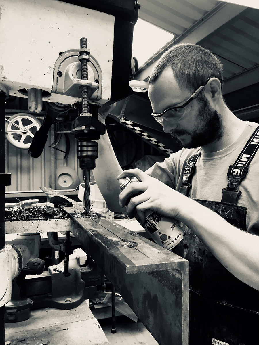 Charlie in the workshop, drilling