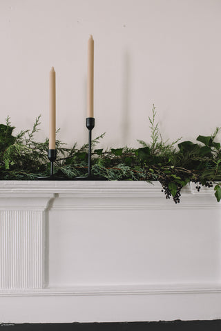 Mantlepiece with foliage garland and taper candles