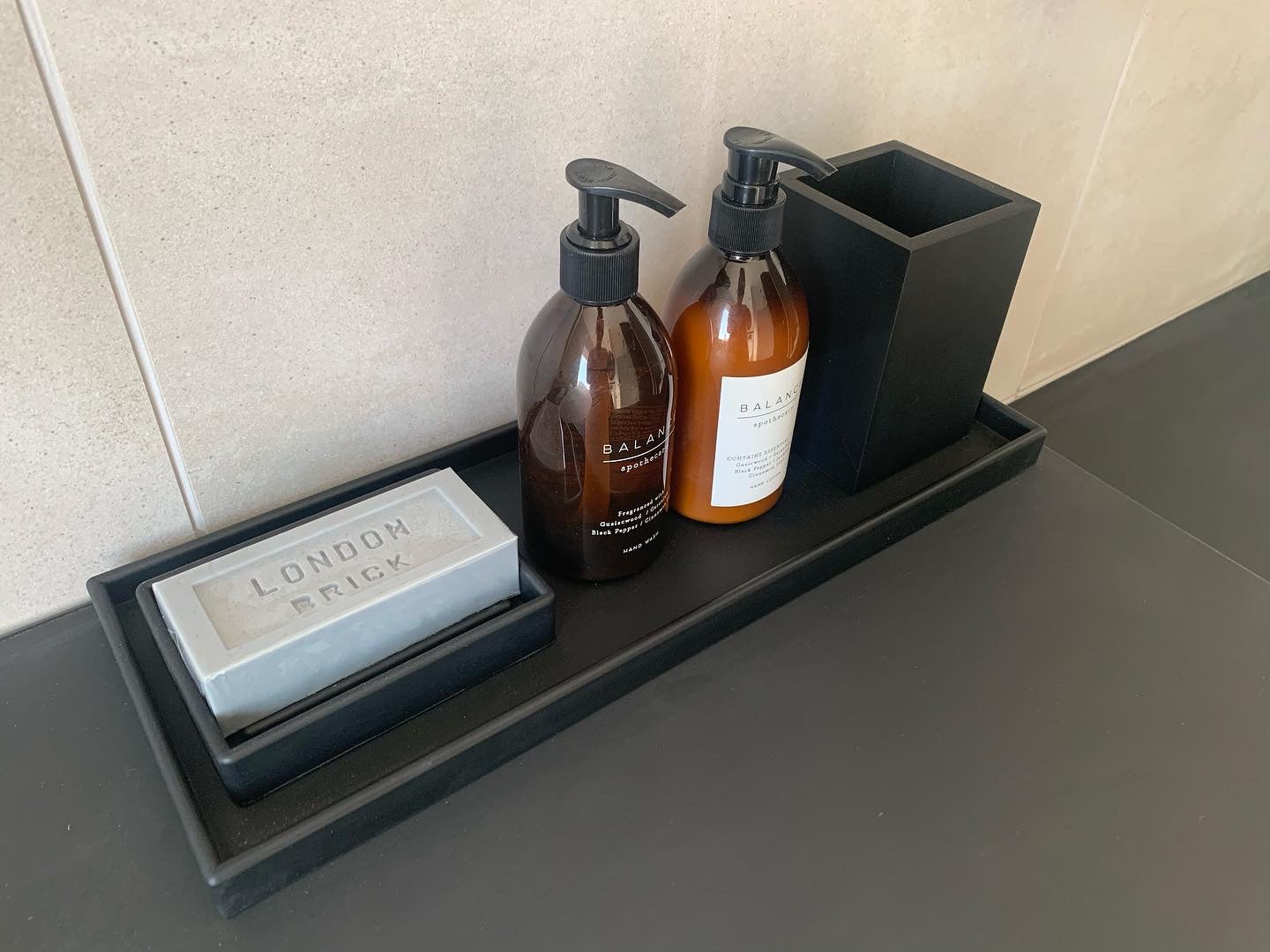 Styled bathroom tray - black rubber with London brick soap