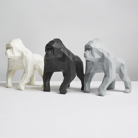 Three geometric monochrome gorilla sculptures