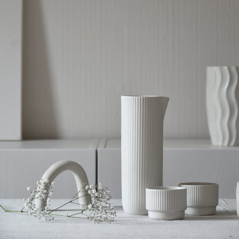 white ceramic jug and cups on kitchen counter