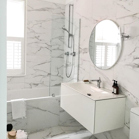 Modern bathroom with marble walls