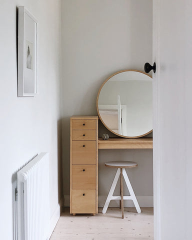Bedroom corner with desk and mirror, light and airy